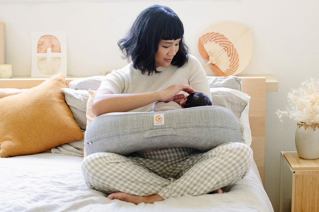 Surviving Family Visits with Baby : 11 Essential Tips | Ergobaby Natural Curve Nursing Pillow in Heather Grey